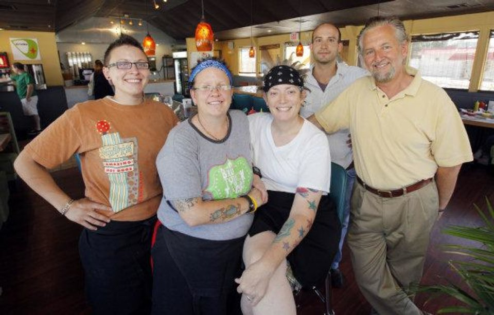 The management team at Mutts Amazing Hot Dogs, from left, Amie Gehlert, Kathryn Mathis, Cally Johnson, Dusty Mickelson and Chris Lower, pose for a photo at Mutts Amazing Hot Dogs in Oklahoma City. Photo by Nate Billings, The Oklahoman <strong>NATE BILLINGS</strong>
