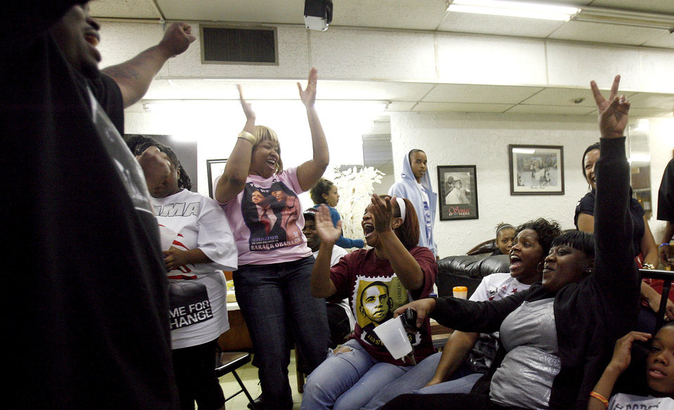 Photo - Obama supporters celebrate after Barack Obama was elected the nation's first black president at the Images of Hair and Nails  salon Tuesday, Nov. .4, 2008, in Oklahoma City. PHOTO BY SARAH PHIPPS, THE OKLAHOMAN