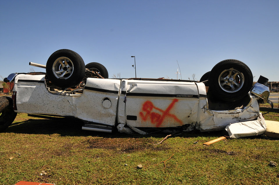 Photo - A vehicle lies upside-down at the Canadian Valley Technology Center in El Reno Okla. on Saturday June 1, 2013 after tornadoes swept through central Oklahoma on Friday. (AP Photo/Nick Oxford)
