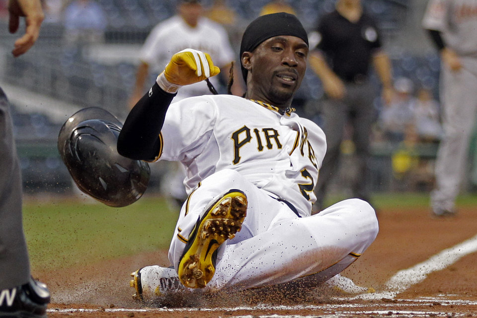 Photo -   Pittsburgh Pirates' Andrew McCutchen scores on a single by Pirates' Gaby Sanchez off Houston Astros pitcher Fernando Abad during the first inning of a baseball game in Pittsburgh, Wednesday, Sept. 5, 2012. (AP Photo/Gene J. Puskar)