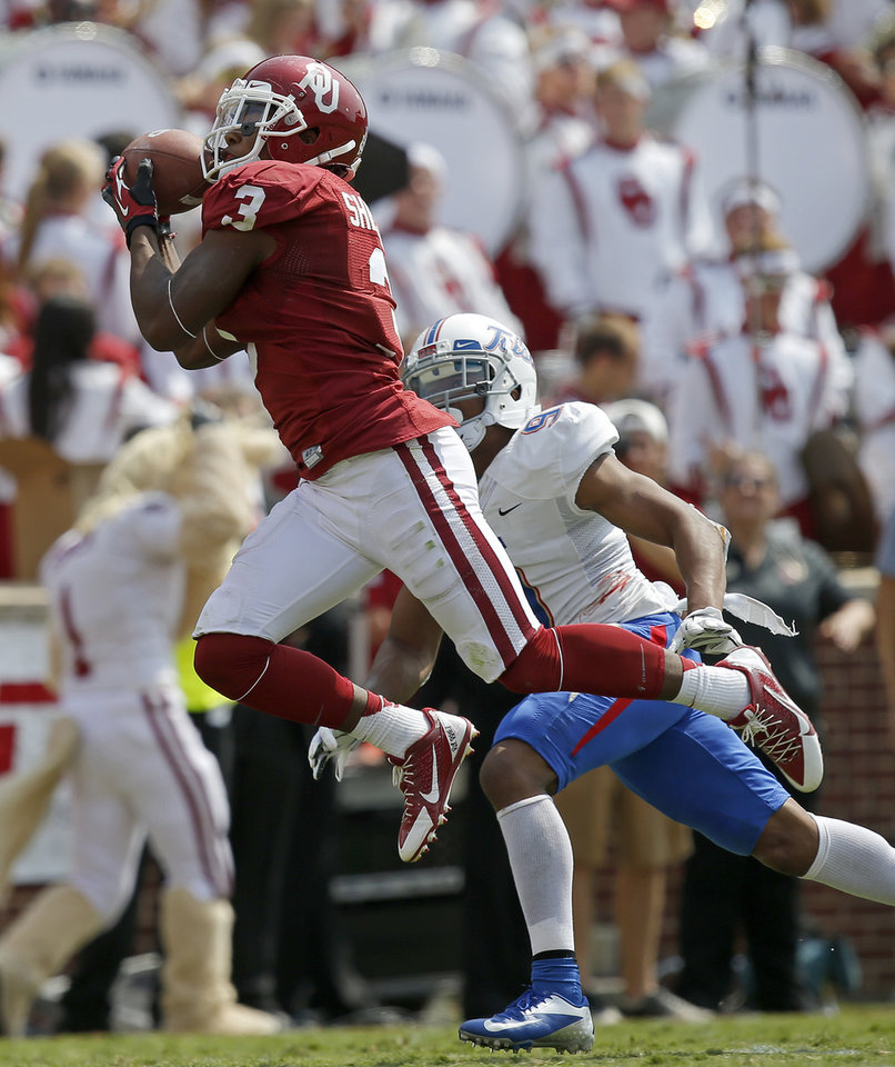 Oklahoma\'s Sterling Shepard (3) catches a touchdown pass n front of Tulsa\'s Dwight Dobbins (9) during a college football game between the University of Oklahoma Sooners (OU) and the Tulsa Golden Hurricane at Gaylord Family-Oklahoma Memorial Stadium in Norman, Okla., on Saturday, Sept. 14, 2013. Oklahoma won 51-20. Photo by Bryan Terry, The Oklahoman