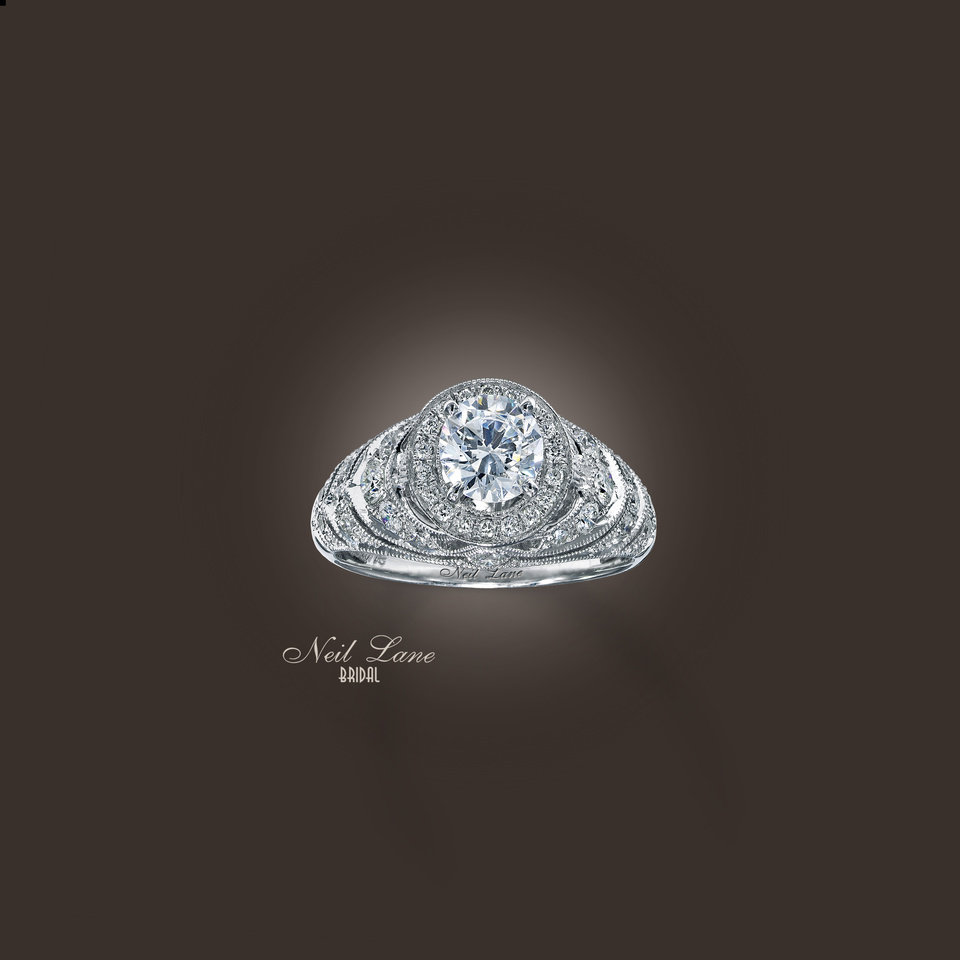 A 14 karat white gold round-diamond engagement ring by Neil Lane for Kay Jewelers.