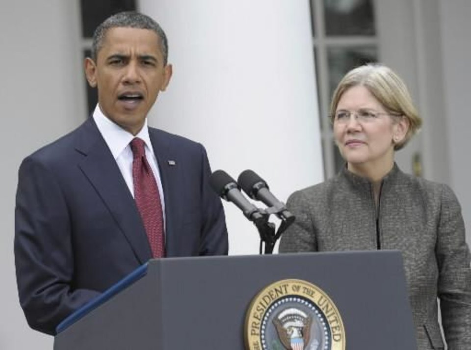 Photo - President Barack  Obama, accompanied by Elizabeth  Warren, announces that  Warren will head the Consumer Financial Protection Bureau, Friday, Sept. 17, 2010, during an event in the Rose Garden of the White House in Washington. AP Photo