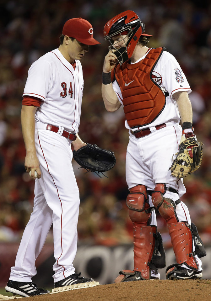 Photo - Cincinnati Reds starting pitcher Homer Bailey (34) talks with catcher Ryan Hanigan in the sixth inning of a baseball game against the St. Louis Cardinals, Tuesday, Sept. 3, 2013, in Cincinnati. (AP Photo/Al Behrman)