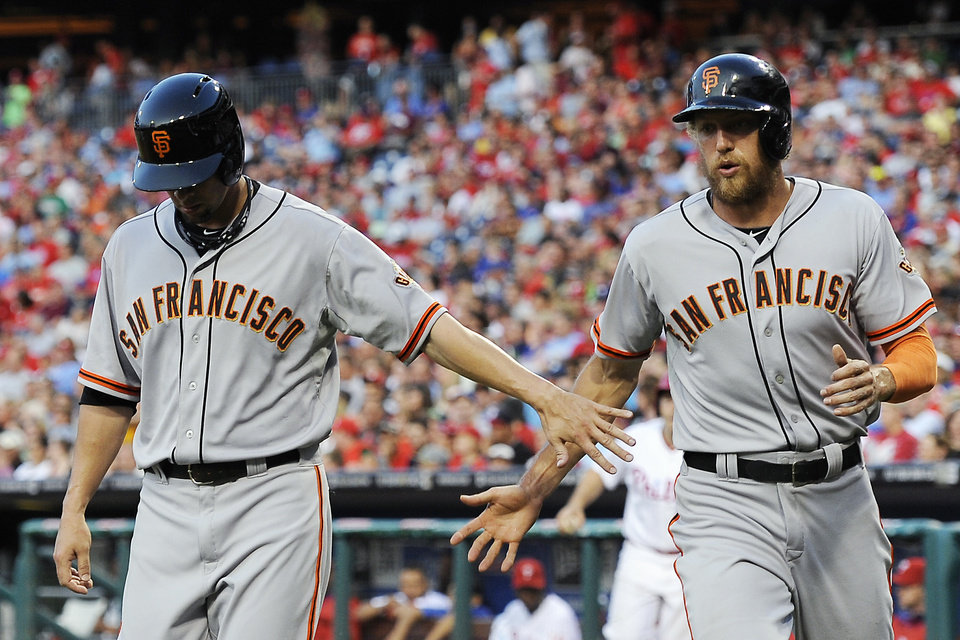 Photo - San Francisco Giants' Ryan Vogelsong, left, celebrates Hunter Pence after they scored on a Buster Posey single in the third inning of a baseball game on Monday, July 21, 2014, in Philadelphia. (AP Photo/Michael Perez)