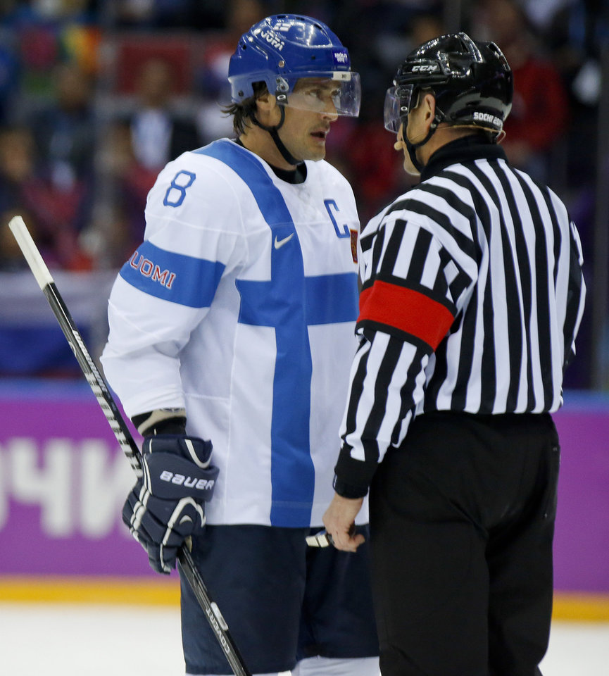Photo - Finland forward Teemu Selanne talks with an official about a penalty shot awarded to the USA during the first period of the men's bronze medal ice hockey game at the 2014 Winter Olympics, Saturday, Feb. 22, 2014, in Sochi, Russia. (AP Photo/Mark Humphrey)