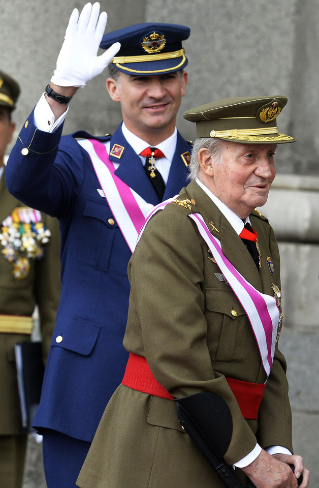 Photo - FILE - In this Monday, Jan. 6, 2014, file photo, Spain's King Juan Carlos, right, and Spain's Crown Prince Felipe, left, attend the annual Pascua Militar Epiphany ceremony at the Royal Palace in Madrid, Spain. Spanish Prime Minister Mariano Rajoy says King Juan Carlos plans to abdicate and pave the way for his son, Crown Prince Felipe, to become the country's next king. The 76-year-old Juan Carlos oversaw his country's transition from dictatorship to democracy but has had repeated health problems in recent years. His popularity also dipped following royal scandals, including an elephant-shooting trip he took in the middle of Spain's financial crisis that tarnished the monarch's image. The king came to power in 1975, two days after the death of longtime dictator Francisco Franco. (AP Photo/Gerard Julien, Pool, File)