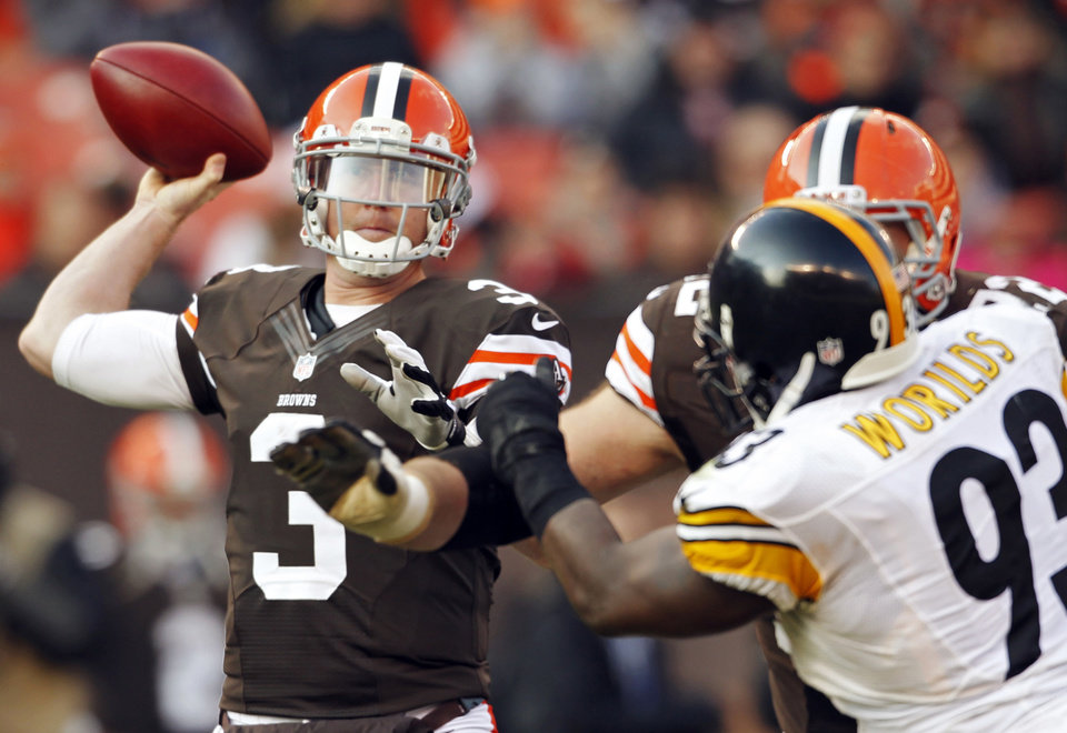 Cleveland Browns quarterback Brandon Weeden (3) passes against the Pittsburgh Steelers in the third quarter of an NFL football game on Sunday, Nov. 25, 2012, in Cleveland. (AP Photo/Ron Schwane)