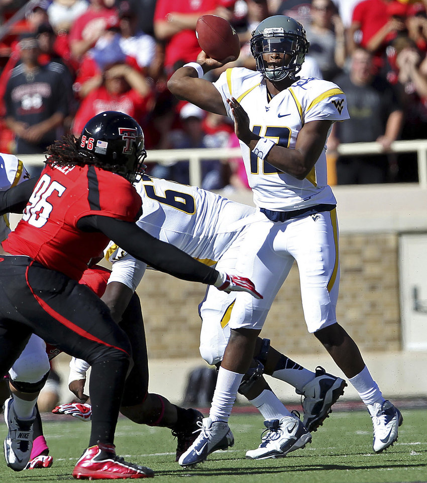 West Virginia's Geno Smith throws under pressure from Texas Tech's Dennell Wesley during an NCAA college football game in Lubbock, Texas, Saturday, Oct. 13, 2012. (AP Photo/Lubbock Avalanche-Journal, Stephen Spillman) LOCAL TV OUT
