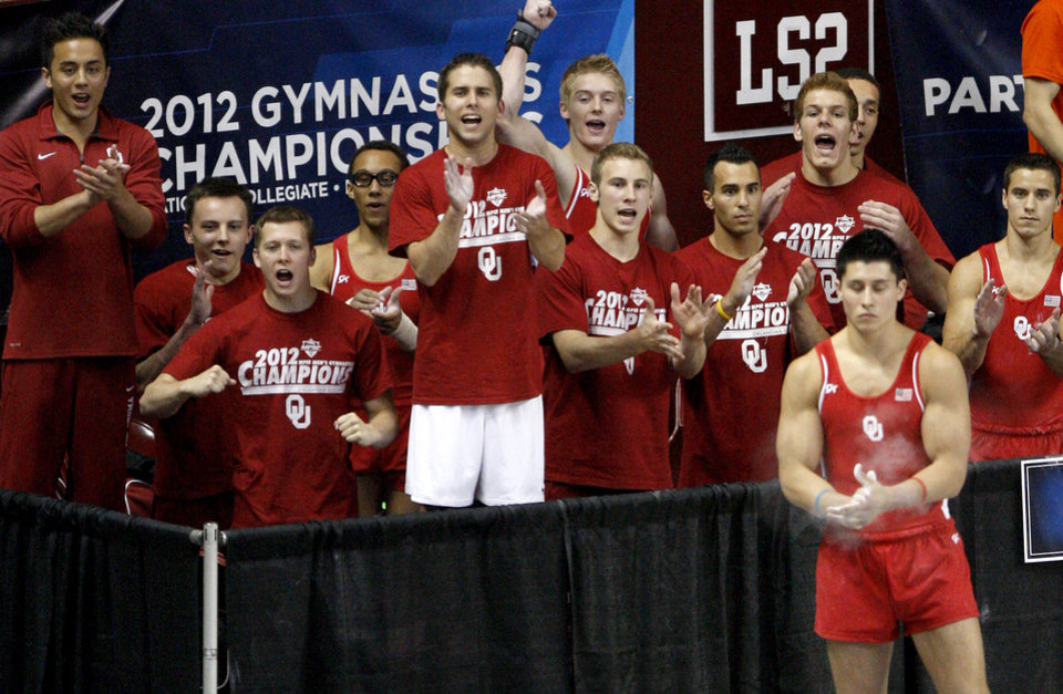 Photo - The Oklahoma team reacts during the men's NCAA college gymnastics championships in at the Lloyd Noble Center in Norman, Okla., Thursday, April19, 2012. Photo by Bryan Terry, The Oklahoman