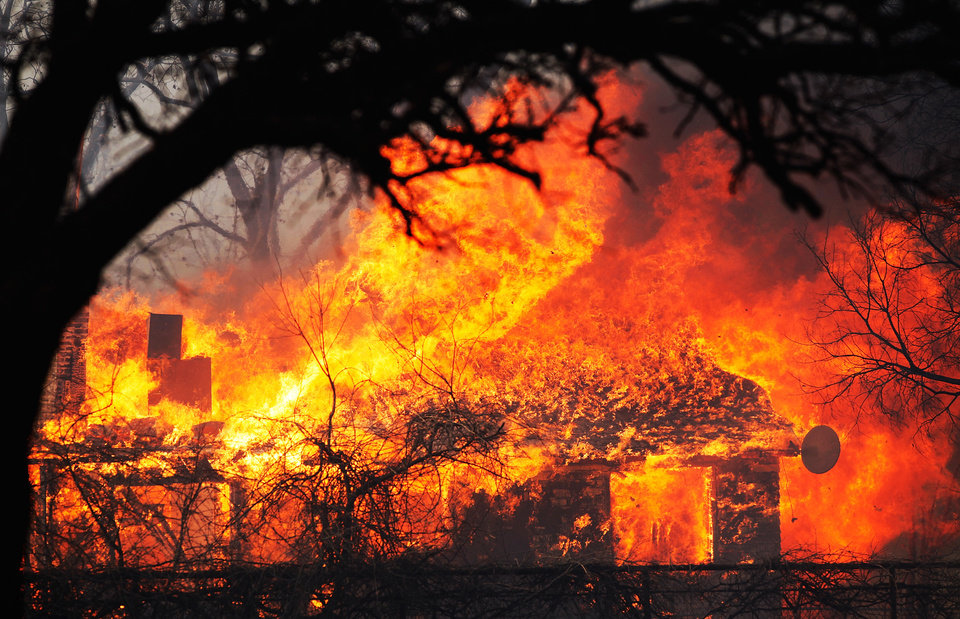 Photo - A house on NE 23 is engulfed in flames. Friday, March 11, 2011. Photo by Jim Beckel, The Oklahoman