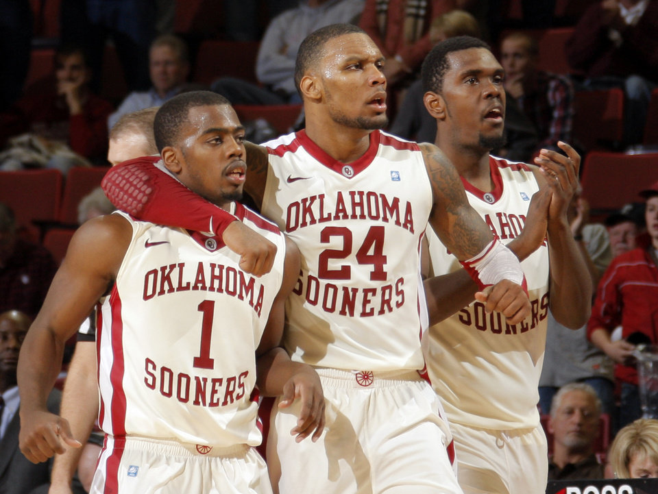 Photo - Oklahoma's Sam Grooms (1), Romero Osby (24) and Oklahoma's Andrew Fitzgerald (4) celebrate during the men's college basketball game between the University of Oklahoma  and Texas Tech University of at the Lloyd Nobel Center in Norman, Okla., Tuesday, Jan. 17, 2012. Photo by Sarah Phipps, The Oklahoman