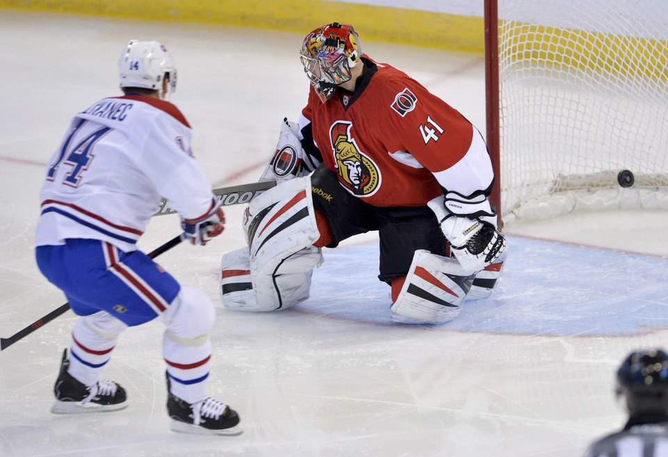 Photo - Montreal Canadiens center Tomas Plekanec scores a short-handed goal on Ottawa Senators goalie Craig Anderson during the first period of an NHL hockey game Thursday, Jan. 16, 2014, in Ottawa, Ontario. (AP Photo/The Canadian Press, Adrian Wyld)