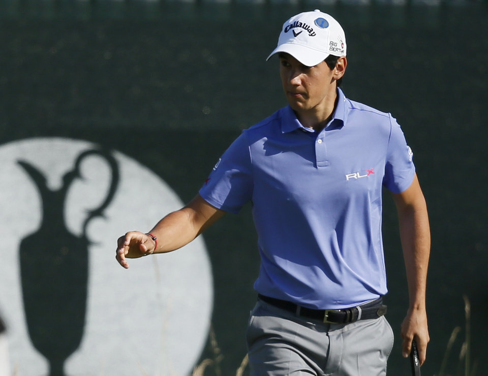Photo - Matteo Manassero acknowledges the crowd after a birdie putt on the 3rd green during the first day of the British Open Golf championship at the Royal Liverpool golf club, Hoylake, England, Thursday July 17, 2014. (AP Photo/Alastair Grant)