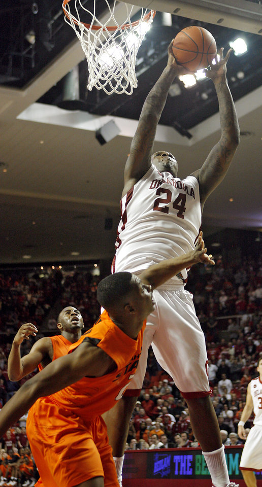 Photo - OU's Tiny Gallon (24) puts up a shot over OSU's Obi Muonelo (2) in the final seconds of overtime in the college bedlam basketball game between The University of Oklahoma Sooners (OU) and Oklahoma State University University Cowboys (OSU) at the Lloyd Noble Center on Monday, Jan. 11, 2010, in Norman, Okla.