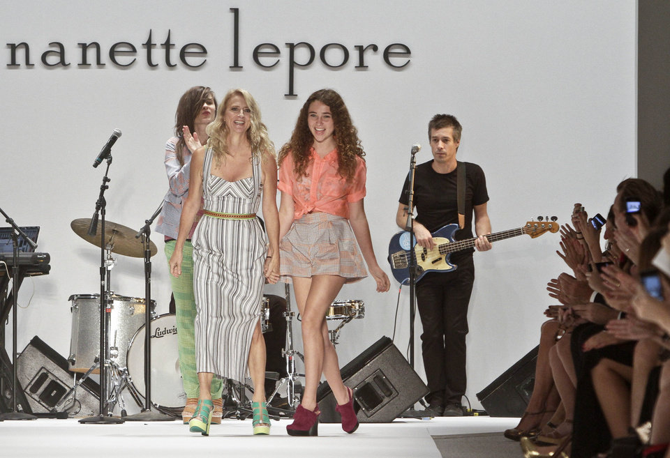 Photo -   Fashion designer Nanette Lepore, left, walks to the runway with her daughter Violet after unveiling her Spring 2013 collection on Wednesday, Sept. 12, 2012 in New York. (AP Photo/Bebeto Matthews)