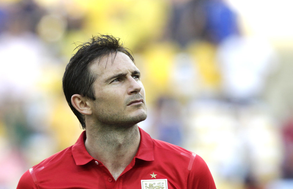 Photo - FILE - In this Sunday, June 2, 2013 file photo, England's Frank Lampard stands during the playing of the British national anthem before the start of an international soccer friendly against Brazil at the Maracana stadium in Rio de Janeiro, Brazil. Frank Lampard has retired from England's national team ahead of qualifying for the 2016 European Championship, it was reported on Tuesday, Aug. 26, 2014. Since making his England debut in 1999, the 36-year-old Lampard has scored 29 goals in 106 appearances, with his last appearance coming at the World Cup in June. (AP Photo/Victor R. Caivano, File)