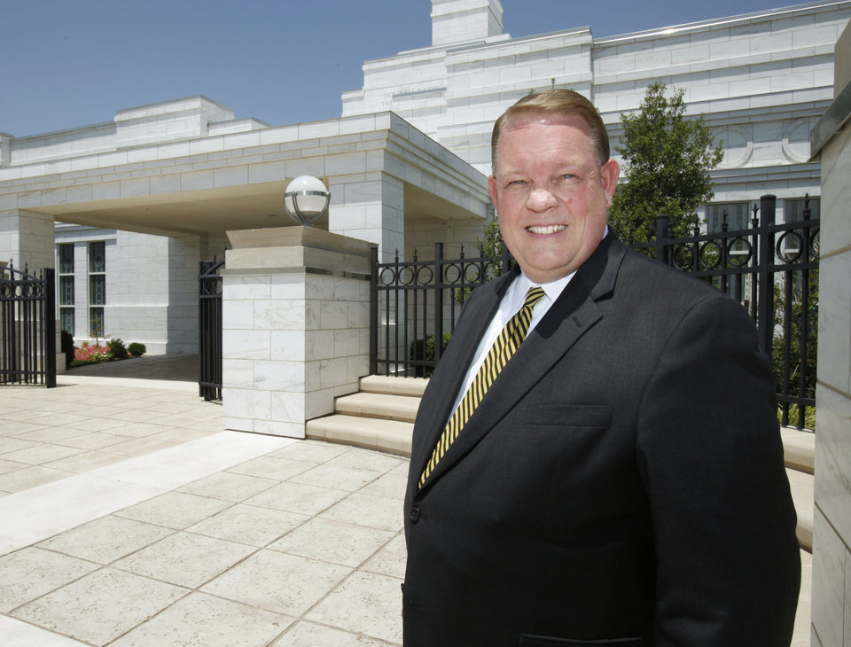Kevin Graves, a leader with the Oklahoma City Stake of the Church of Jesus Christ of Latter-day Saints, poses in front of the LDS Surrey Hills Temple in Yukon, OK, Tuesday, July 5, 2011. By Paul Hellstern, The Oklahoman ORG XMIT: KOD