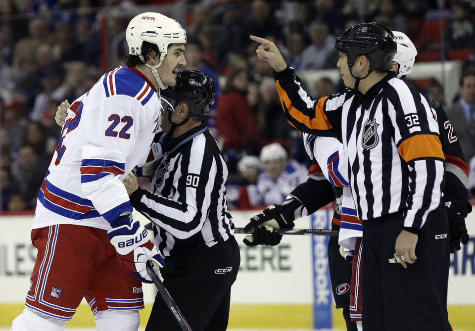 Photo - New York Rangers' Brian Boyle (22) argues with officials after being assessed a penalty during the second period of an NHL hockey game against the Carolina Hurricanes in Raleigh, N.C., Friday, March 7, 2014. (AP Photo/Gerry Broome)