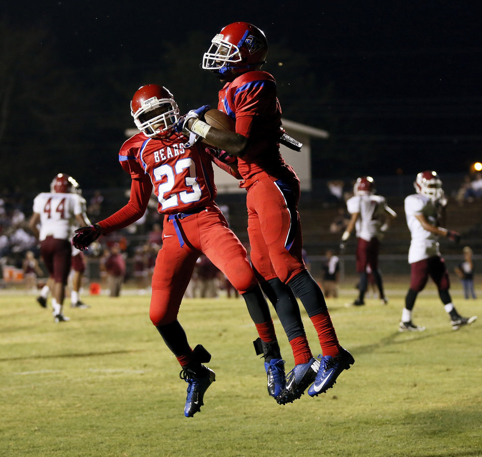 John Marshall's Dez Jackson (23) and Devion Smith (7) celebrate a touchdown by Smith during a high school football game between John Marshall and Crooked Oak at Star Spencer's Carl Twidwell Stadium, 3001 NE Spencer Rd., in Spencer, Okla., Thursday, Sept. 19, 2013. Photo by Nate Billings, The Oklahoman