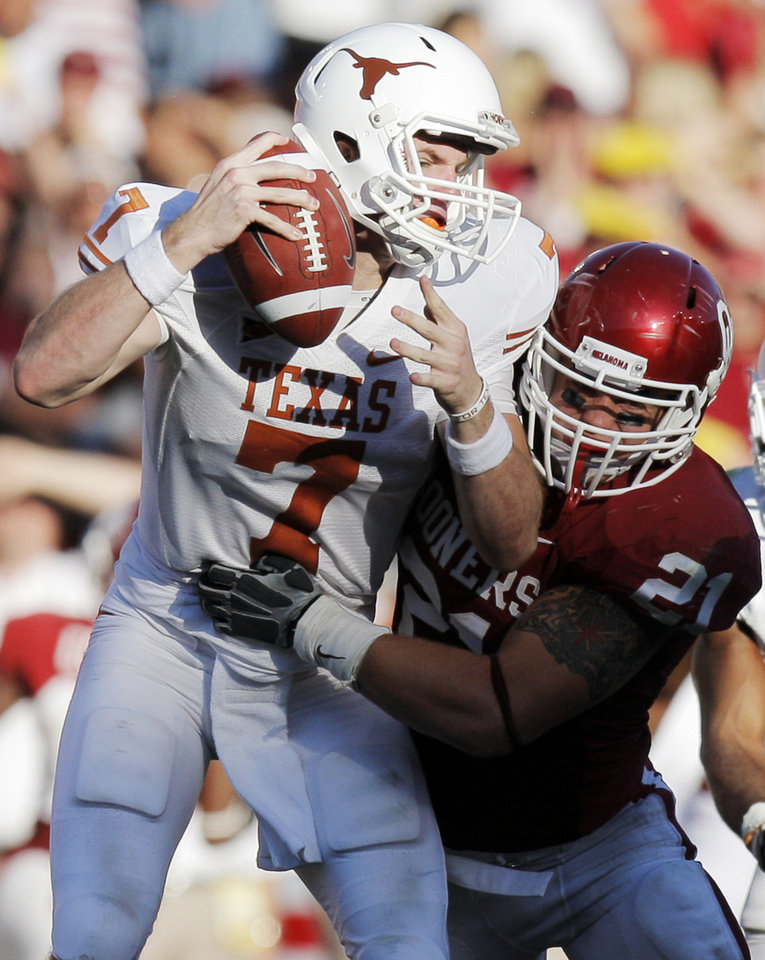 Texas quarterback Garrett Gilbert (7) is sacked by OU's Tom Wort (21) in the fourth quarter during the Red River Rivalry college football game between the University of Oklahoma Sooners (OU) and the University of Texas Longhorns (UT) at the Cotton Bowl on Saturday, Oct. 2, 2010, in Dallas, Texas. OU won, 28-20. Photo by Nate Billings, The Oklahoman