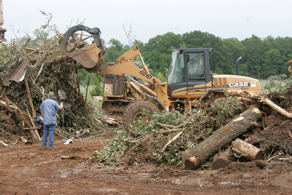 Photo - STORM / TORNADO DAMAGE / AFTERMATH / CLEAN UP / CLEANUP: Oklahoma County District 2 workers sort storm debris at Oklahoma County's burn pit near Harrah , Oklahoma May 19 , 2010. Photo by Steve Gooch, The Oklahoman ORG XMIT: KOD