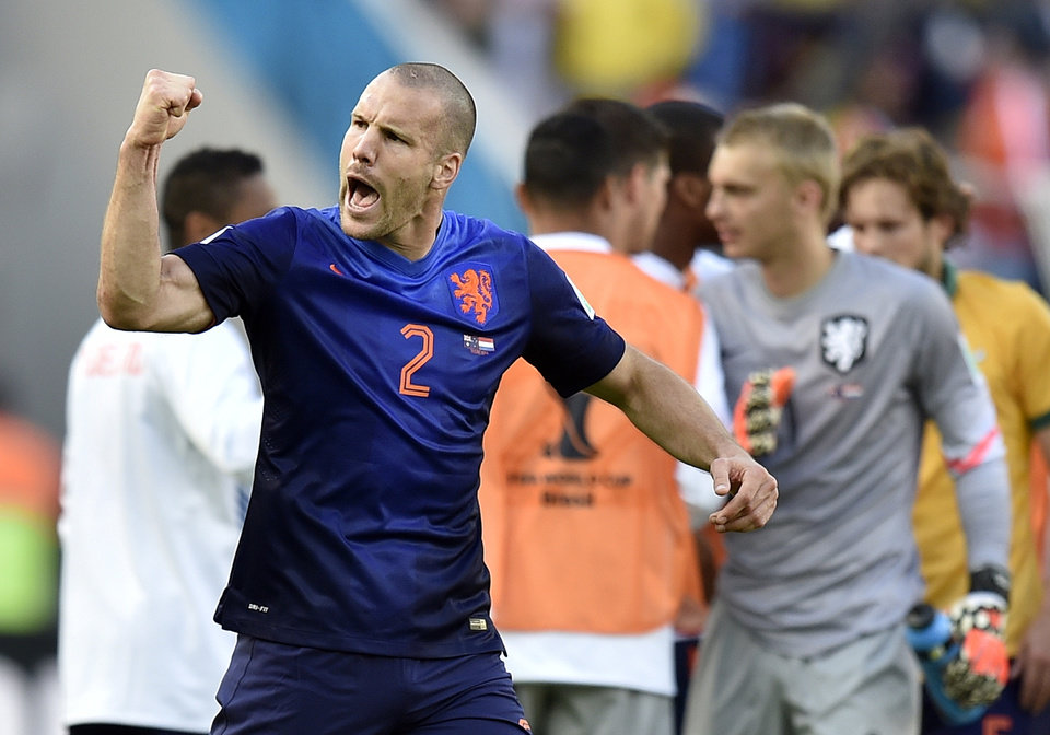 Photo - Netherlands' Ron Vlaar celebrates after the group B World Cup soccer match between Australia and the Netherlands at the Estadio Beira-Rio in Porto Alegre, Brazil, Wednesday, June 18, 2014.  The Netherlands won the match 3-2.    (AP Photo/Martin Meissner)