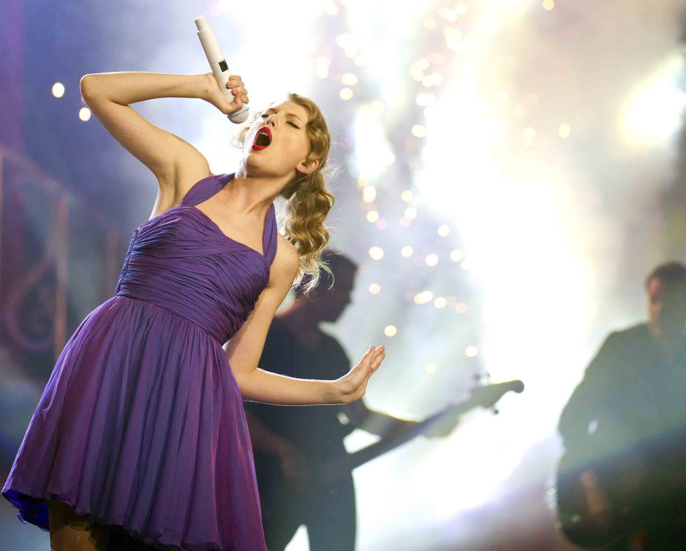 """Photo -   FILE - This Nov. 22, 2011 file photo shows singer Taylor Swift performing at Madison Square Garden in New York. Swift will go for her third entertainer of the year award at this year's Country Music Association Awards. The two-time winner is nominated in the category with previous winners Kenny Chesney and Brad Paisley and Jason Aldean and Blake Shelton. Aldean and Luke Bryan announced the first five categories of CMA nominees on """"Good Morning America."""" The 46th annual CMA Awards will be aired live Nov. 1 on ABC from Nashville's Bridgestone Arena. Carrie Underwood and Paisley will host. (AP Photo/Charles Sykes, file)"""