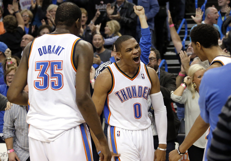 Oklahoma City's Russell Westbrook (0) celebrates his game-winning three-pointer during overtime in the NBA game between the Oklahoma City Thunder and the Golden State Warriors at the Chesapeake Energy Arena, Friday, Nov. 29, 2013. Photo by Sarah Phipps, The Oklahoman