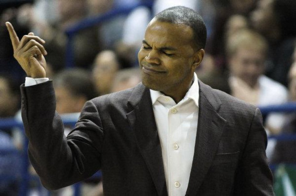 Harvard head coach Tommy Amaker gestures during first half of an NCAA college basketball game in a playoff for the Ivy League championship against Princeton at Yale University in New Haven, Conn., Saturday, March 12, 2011.(AP Photo/Jessica Hill) <strong>Jessica Hill</strong>