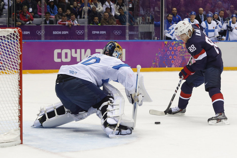 Photo - USA forward Patrick Kane takes a penalty shot against Finland goaltender Tuukka Rask during the first period of the men's bronze medal ice hockey game at the 2014 Winter Olympics, Saturday, Feb. 22, 2014, in Sochi, Russia.  Kane missed the shot. (AP Photo/Mark Humphrey)