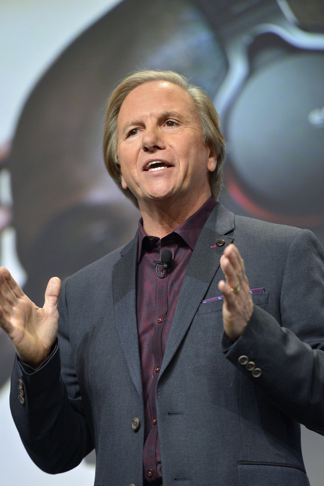 Photo - Mike Fasulo, president and chief operating officer of Sony Electronics, Inc., talks to the media during the Sony news conference at the International Consumer Electronics Show Monday, Jan. 6, 2014, in Las Vegas. (AP Photo/Jack Dempsey)