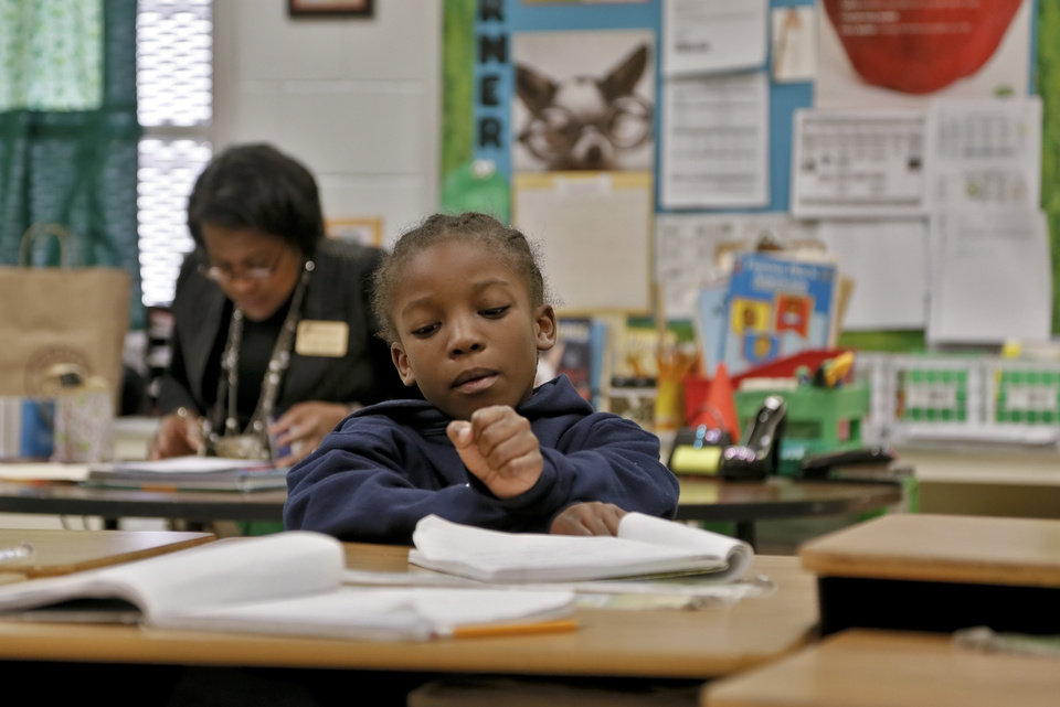 Photo - First grader Terry Beamon works in Tonda Smith's class at North Highland Elementary on Tuesday, Jan. 15, 2013, in Oklahoma City, Okla. The school has been one of the most effected in the metro by the arrival of flu season.   Photo by Chris Landsberger, The Oklahoman