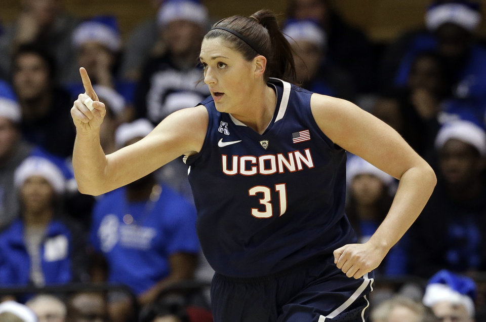 Photo - Connecticut's Stefanie Dolson (31) reacts following her basket against Duke during the first half of an NCAA college basketball game in Durham, N.C., Tuesday, Dec. 17, 2013. Connecticut won 83-61. (AP Photo/Gerry Broome)