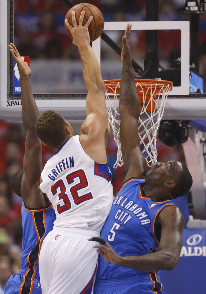 Photo - Oklahoma City's Kendrick Perkins and  Serge Ibaka (9) defend against Los Angeles' Blake Griffin (32) during Game 6 of the Western Conference semifinals in the NBA playoffs between the Oklahoma City Thunder and the Los Angeles Clippers at the Staples Center in Los Angeles, Thursday, May 15, 2014. Photo by Nate Billings, The Oklahoman