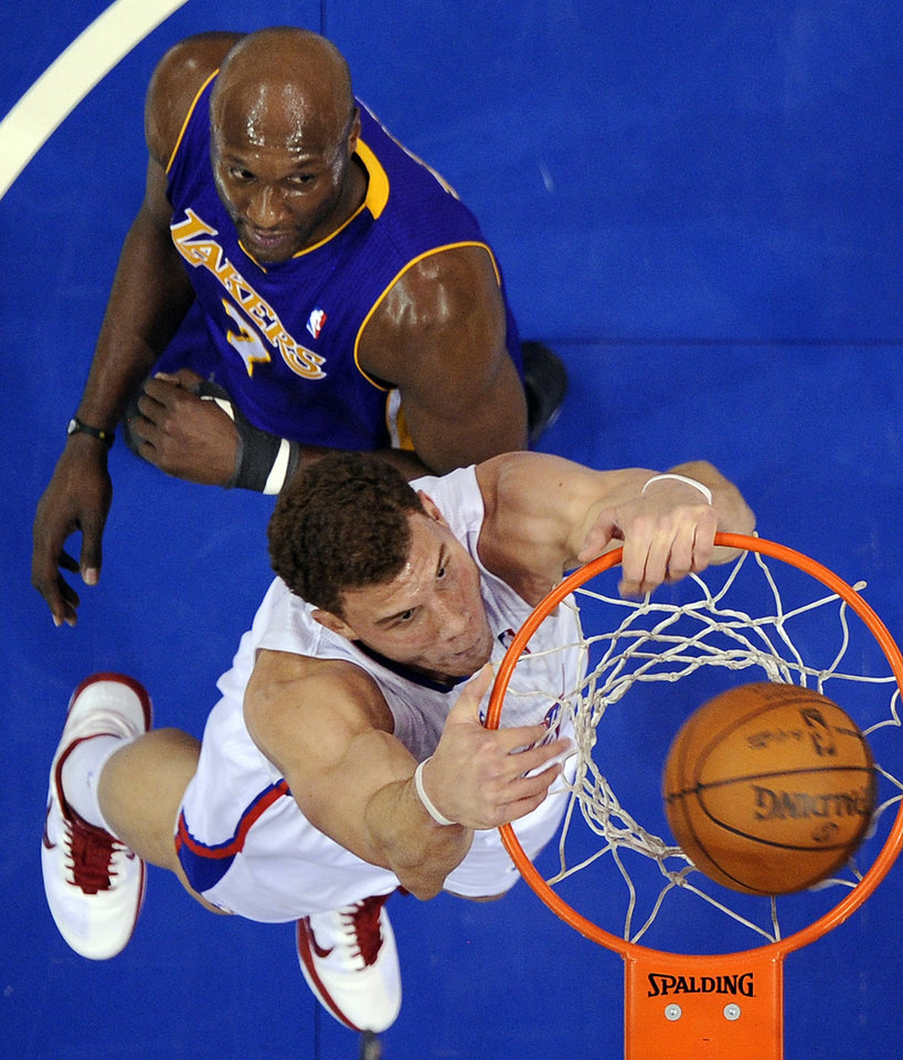 Los Angeles Clippers power forward Blake Griffin, below, dunks as Los Angeles Lakers power forward Lamar Odom looks on during the first half of their NBA basketball game, Wednesday, Dec. 8, 2010, in Los Angeles. (AP Photo/Mark J. Terrill) ORG XMIT: LAS103