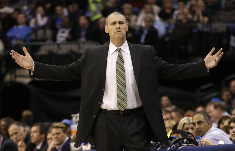Photo - Dallas Mavericks head coach Rick Carlisle looks for the call during the first half of an NBA basketball game against the Golden State Warriors Saturday, Feb. 9, 2013, in Dallas. The Mavericks won 116-91. (AP Photo/LM Otero)