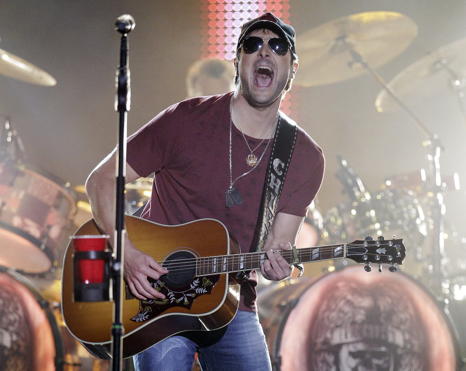 Photo -   FILE - This June 6, 2012 file photo shows Eric Church performing on an outdoor stage during the CMT Music Awards show in Nashville, Tenn. Church was nominated for five Country Music Association Awards, including album of the year, male vocalist, single and song of the year categories,Wednesday, Sept. 5, during an announcement on