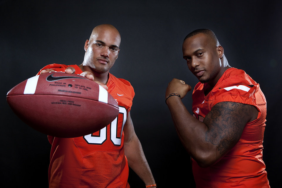 Oklahoma State's Jamie Blatnick (50) and Richetti Jones (99) pose for a photo during Oklahoma State's Football media day at  in Stillwater, Okla., Saturday, Aug. 6, 2011. Photo by Sarah Phipps, The Oklahoman