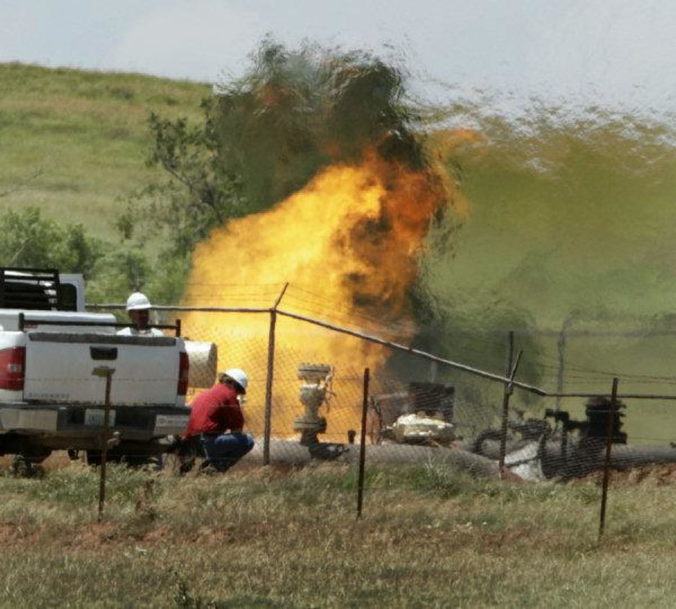 Photo - The fire continued to burn around noon Tuesday at the site of a natural gas pipeline  explosion in Grady County, west of Pocasset.  Photo by Steve Sisney, The Oklahoman ORG XMIT: KOD  STEVE SISNEY - THE OKLAHOMAN