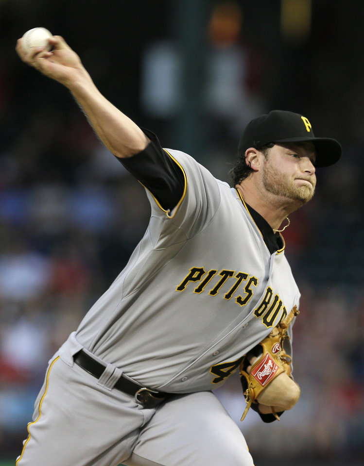 Photo - Pittsburgh Pirates starting pitcher Gerrit Cole works against the Texas Rangers in the first inning of a baseball game, Monday, Sept. 9, 2013, in Arlington, Texas. (AP Photo/Tony Gutierrez)