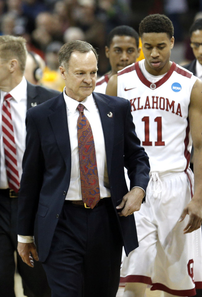 Photo - Oklahoma head coach Lon Kruger leaves the court following the Sooners' overtime loss in the NCAA men's basketball tournament game between the University of Oklahoma and North Dakota State at the Spokane Arena in Spokane, Wash., Thursday, March 20, 2014. Oklahoma home lost 80-75. Photo by Sarah Phipps, The Oklahoman