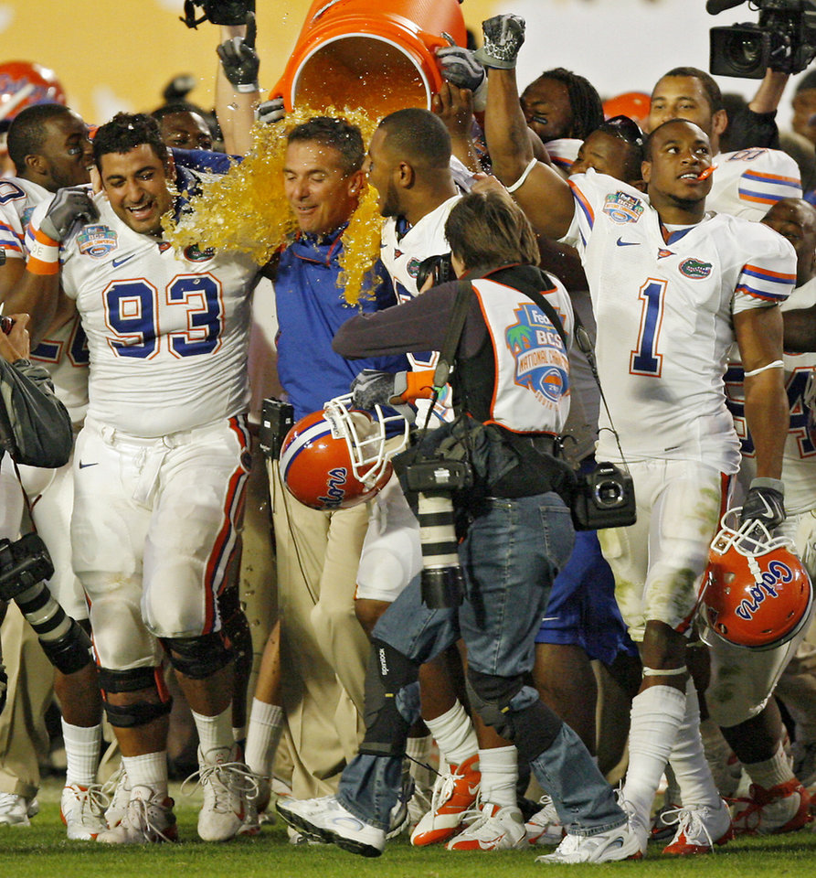 Photo - Florida coach Urban Meyer gets soaked by his team during the second half of the BCS National Championship college football game between the University of Oklahoma Sooners (OU) and the University of Florida Gators (UF) on Thursday, Jan. 8, 2009, at Dolphin Stadium in Miami Gardens, Fla. Oklahoma lost the game 24-14 to the Gators.PHOTO BY CHRIS LANDSBERGER, THE OKLAHOMAN