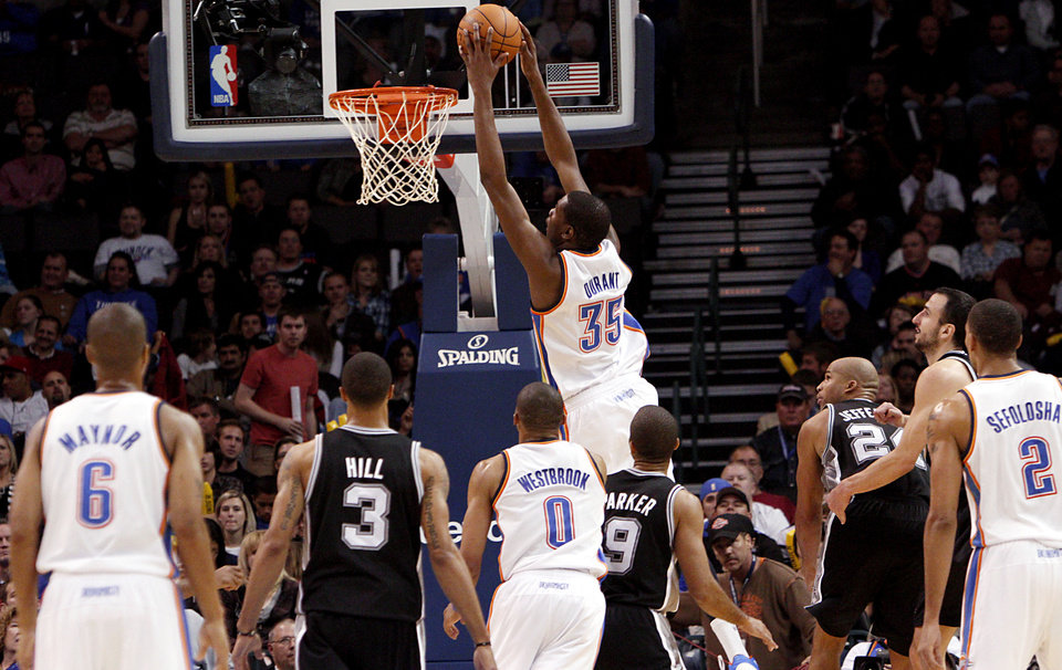 Photo - Oklahoma City's Kevin Durant puts of a slam dunk against San Antonio during their NBA basketball game in downtown Oklahoma City  on Sunday, Nov. 14, 2010. The Thunder lost to the Spurs 117-104. Photo by John Clanton, The Oklahoman