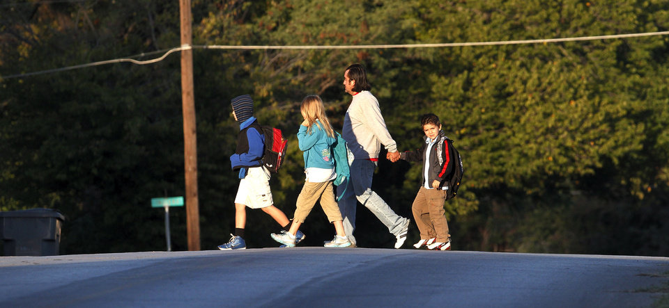 Taking part in National Walk to School Day, students and their parents are joined by community members  as well as teachers and staff  as they walk as a group  along NE 50th Street to begin the school day at Spencer Elementary on Wednesday, Oct. 3, 2012.   Photo by Jim Beckel, The Oklahoman.