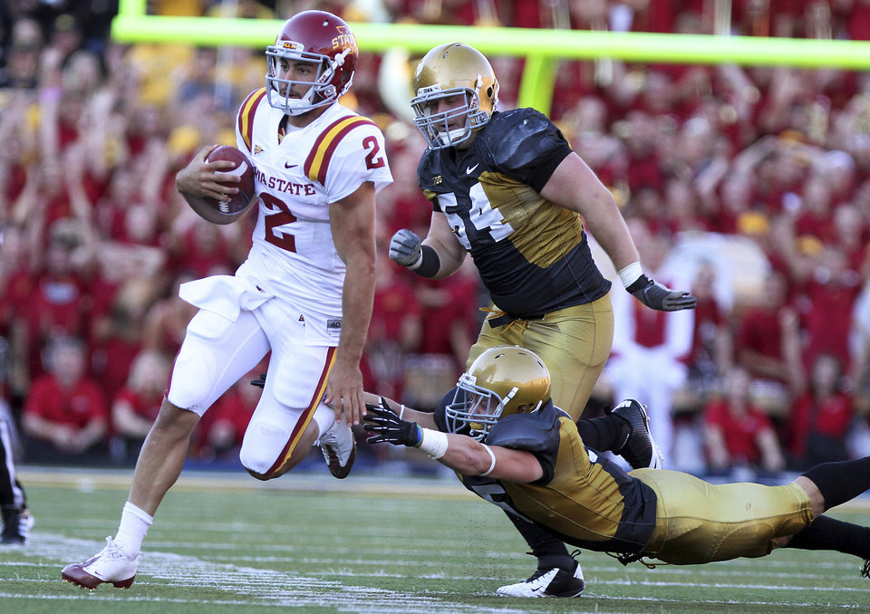 Photo -   Iowa State quarterback Steele Jantz runs away from Iowa's Steve Bigach, rear, and Tanner Miller for a first down during the fourth quarter of an NCAA college football game Saturday, Sept. 8, 2012 in Iowa City, Iowa. Iowa State won 9-6. (AP Photo/Conrad Schmidt)