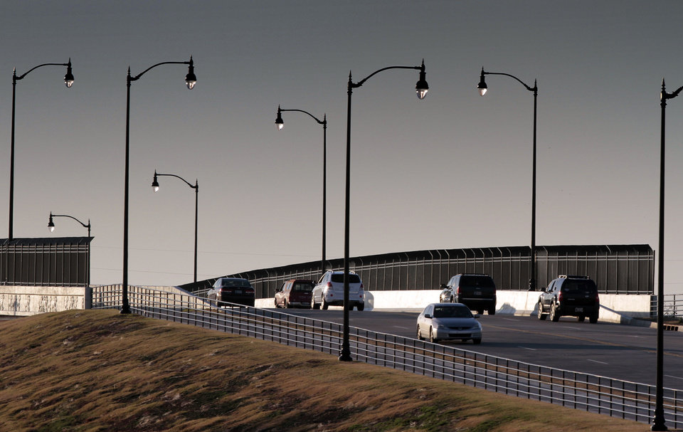 Photo - Traffic moves over and under the Rock Creek Bridge over Interstate 35 in Norman.  Photo by Steve Sisney, The Oklahoman