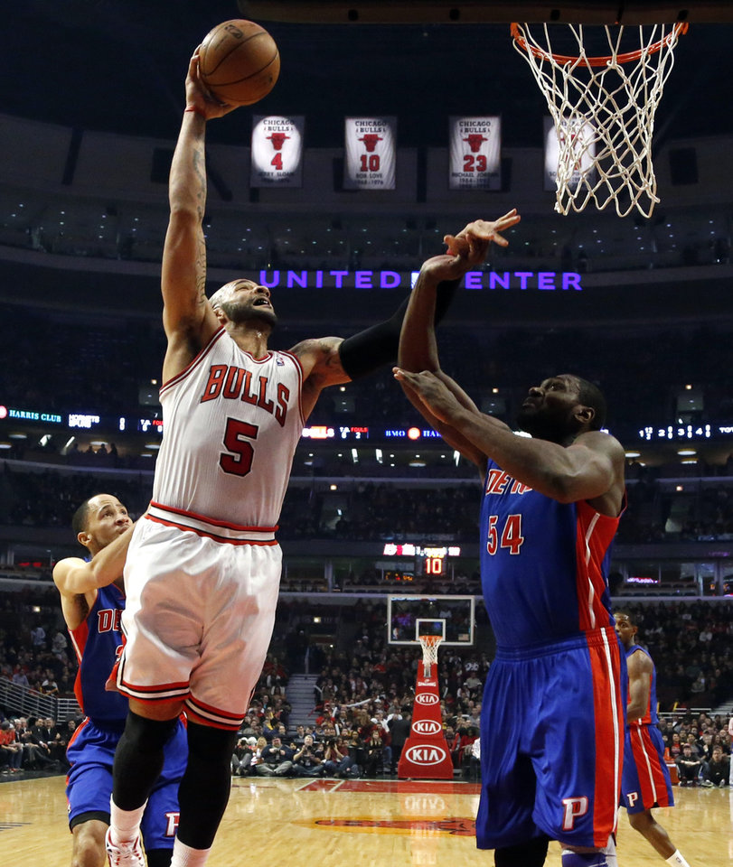 Chicago Bulls forward Carlos Boozer (5) shoots over Detroit Pistons forward Jason Maxiell (54) during the first half of an NBA basketball game, Wednesday, Jan. 23, 2013, in Chicago. (AP Photo/Charles Rex Arbogast)
