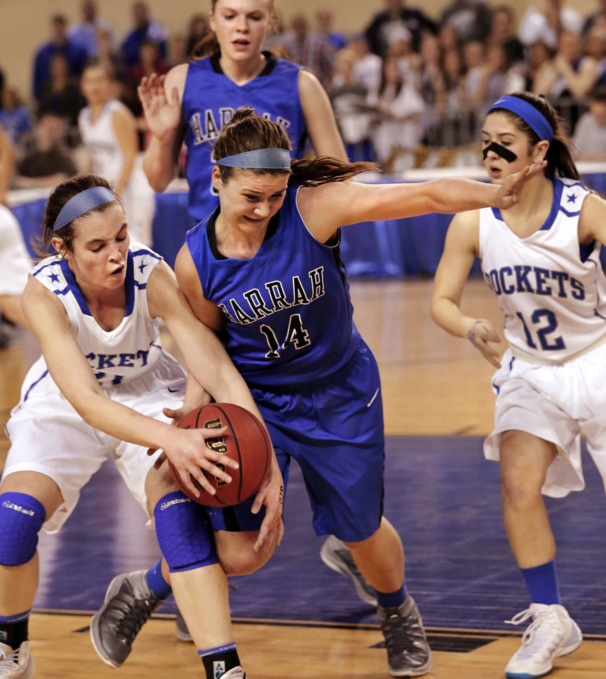 Photo - St. Mary player Kaley Bond, left, reaches for a loose ball after it was knocked from the hands of Harrah player Shanna Visnieski by MSM's Chloe Glass during the Class 4A girls basketball quarterfinal game between Mount St. Mary and Harrah at Jim Norick Arena at State Fair Park  on Thursday night, Mar. 13, 2014. Photo by Jim Beckel, The Oklahoman