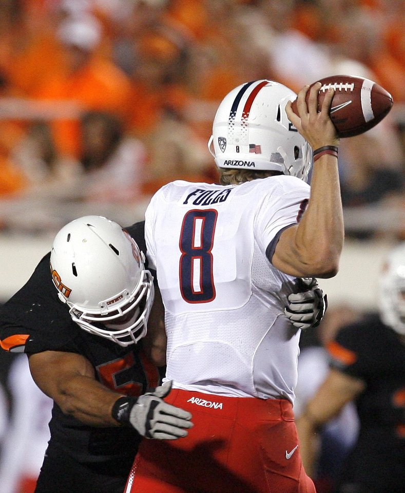 Photo - Oklahoma State's Jamie Blatnick pressures Arizona's Nick Foles during their game Thursday. PHOTO BY SARAH PHIPPS, The Oklahoman